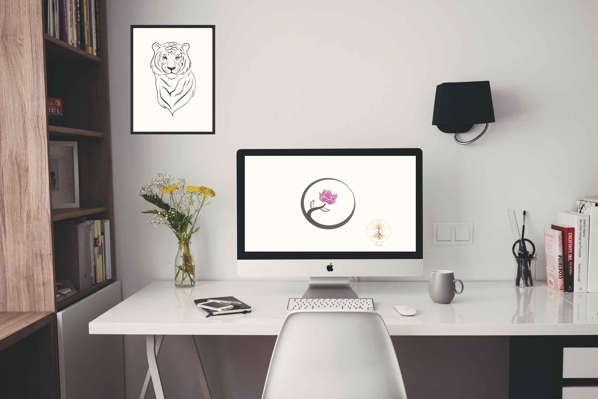 Image of a home office mockup featuring two of ABLG Design's logos including a tiger and a flower.